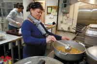 Ana Rodriguez prepares a big pot of soup Thursday at the newly opened kitchen at the Spanish American Center in Leominster. SENTINEL & ENTERPRISE / JOHN LOVE