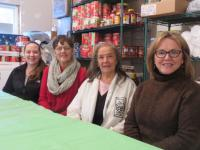 ÒThe point right now is to feed people warm meals while itÕs cold out,Ó said Sue Chalifoux Zephir, right, director of GinnyÕs Helping Hands. SheÕs joined by Spanish American Center Executive Director Neddy Latimer, second from right, and volunteers Danielle Pierce, left, and Pat Freiss.SENTINEL & ENTERPRISE / PETER JASINSKI