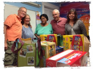 SAC Board members JP Bissy, Angelita Santiago, Richard Letart and Yanneth Bermudiez-Camp present food and household products donated to Neddy Latimer, Director!