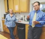 Leominster Spanish American Center staff members Neddy Latimer, left, and Nicolas Formaggia discuss the renovated facility on Spruce Street on Monday, while standing in the renovated kitchen.SENTINEL & ENTERPRISE / Ashley Green