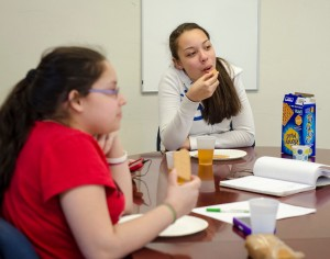 Autumn Sophia Burgos enjoys a snack during the new afterschool program at the Leominster Spanish American Center on Wednesday afternoon. SENTINEL & ENTERPRISE / Ashley Green