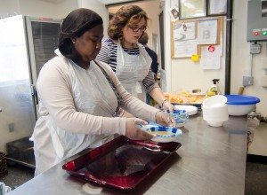 Volunteers Randy Duong and Paula Franco serve up soup during the new afterschool program at the Leominster Spanish American Center on Wednesday afternoon. SENTINEL & ENTERPRISE / Ashley Green