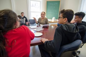 Youth Specialist Christina Gonzalez works with a group of kids during the new afterschool program at the Leominster Spanish American Center on Wednesday afternoon. SENTINEL & ENTERPRISE / Ashley Green