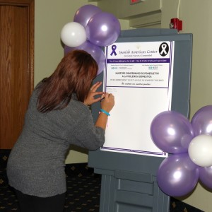 "Signing the ""NO MAS"" pledge."