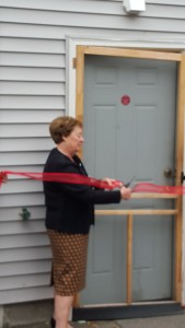 Mrs. Higgins cuts the ribbon, officially opening the new facility - The David Higgins Cocina and Activity Center!